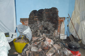 Removing the brick work inside the chamber of the fire place