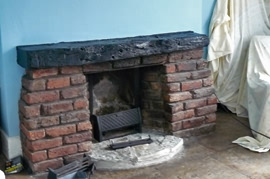 Our task involved removing the 1950's hearth and gas fire