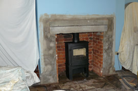 Clean and point the original brickwork, fit hearth and plaster as required